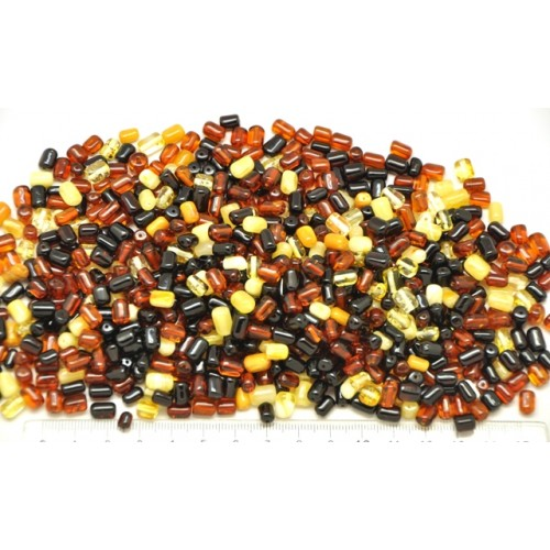 Loose drilled Baltic amber small barrel pieces 100 g